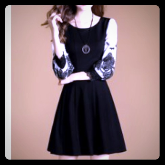 Dresses & Skirts - Black & white lace lace sleeve A Line dress.